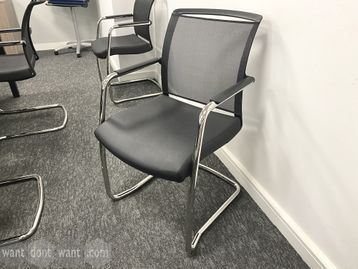 Smart used meeting chairs with mesh backs and black leatherette seat. Chrome cantilever frame.