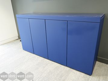 Used contemporary design blue storage unit with push catch doors and glass top