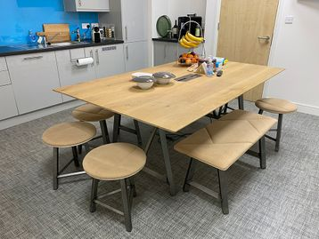 A magnificent used 'Frovi' oak top table with raw steel legs