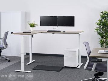 Brand new L-shaped height adjustable desk with smooth operating triple motor system.