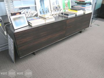 Used credenza unit with black leather carcass and sliding walnut doors.
