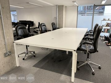 Used 6-person white bench desks. Each desk position 1400mm wide.