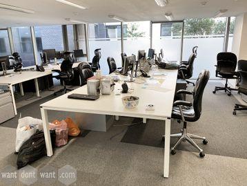 Used 8-person white bench desks. Comprises of 4 x back-to-back desks each 1400mm wide x 1600mm deep.