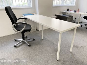 Used white tables 2000mm wide x 600mm deep.