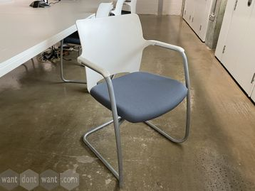 Stacking meeting chairs with white plastic backs