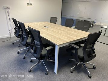 An impressive used meeting table with aged oak style top and white metal frame