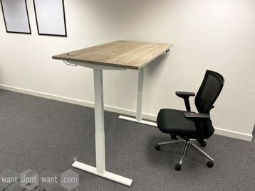 Superb used electric height-adjustable desks with aged oak style tops