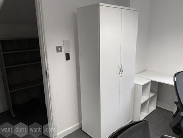 Used tall white double door storage cupboard with shelves