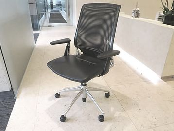 Vitra 'Meda' chairs with black leather seat mesh back and chrome frame