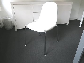 White Magis 'Butterfly' chairs with chrome legs. Designed by Karim Rashid