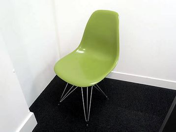 Green breakout chairs in based on a design by Charles Eames.