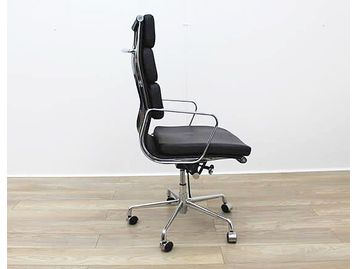 Charles Eames Style black leather faced swivel chairs with chrome arms and base