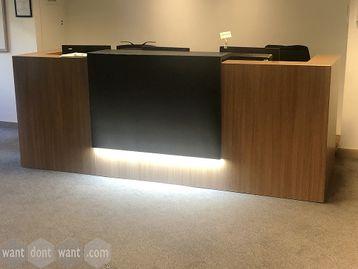 Never Used walnut reception desk with concealed lighting under centre panel