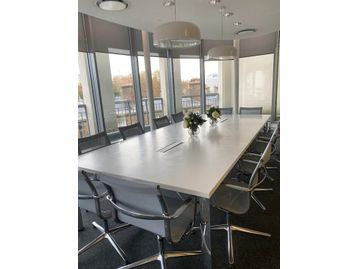 Used Boss 'Apollo' boardroom table with white Corian top.