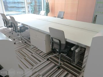 Used 'Naos System' bench desks by Unifor. Stunning white glass tops with polished aluminium edging.