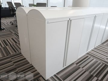 Used domed-top white double door storage cupboards
