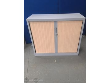 Used storage cupboard with grey metal carcass and beech side tambour doors