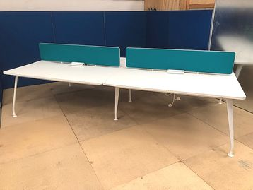 Modern used 1600mm white bench desks with white splayed legs.