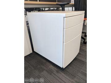 White under-desk 3-drawer mobile pedestals with keys.