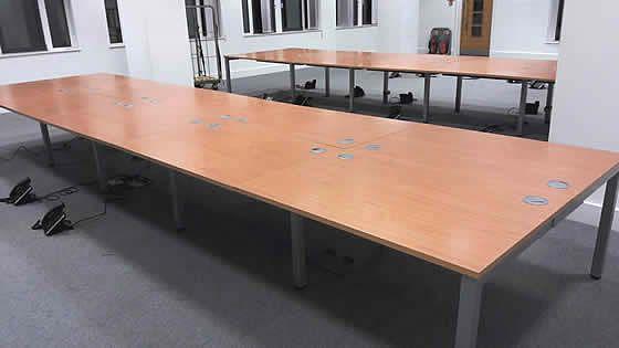 1200mm beech bench desks with goalpost legs.